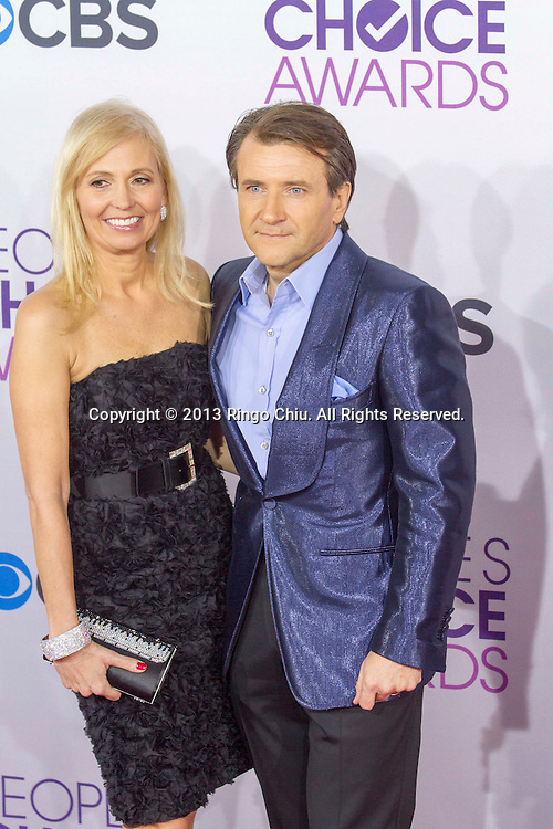 Entrepeneur Robert Herjavec (R) arrives at the 39th Annual People's Choice Awards at Nokia Theatre L.A. Live on Wednesday January 9, 2013 in Los Angeles, California, United States. (Photo by Ringo Chiu/PHOTOFORMULA.com)