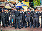03 SEPTEMBER 2016 - BANGKOK, THAILAND: Bangkok code enforcement officers are briefed on their operation to evict residents of the Pom Mahakan Fort. Hundreds of people from the Pom Mahakan community and other communities in Bangkok barricaded themselves in the Pom Mahakan Fort to prevent Bangkok officials from tearing down the homes in the community Saturday. The city had issued eviction notices and said they would reclaim the land in the historic fort from the community. People prevented the city workers from getting into the fort. After negotiations with community leaders, Bangkok officials were allowed to tear down 12 homes that had either been abandoned or whose owners had agreed to move. The remaining 44 families who live in the fort have vowed to stay.      PHOTO BY JACK KURTZ