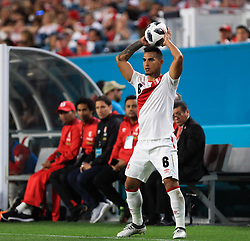 March 23, 2018 - Miami Gardens, Florida, USA - Peru defender Miguel Trauco (6) sets up for a throw in during a FIFA World Cup 2018 preparation match between the Peru National Soccer Team and the Croatia National Soccer Team at the Hard Rock Stadium in Miami Gardens, Florida. (Credit Image: © Mario Houben via ZUMA Wire)