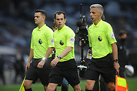 Football - 2020 /2021 Premier League - Tottenham Hotspur vs Newcastle United<br /> <br /> Referee, Peter Bankes, walks off after the match with his officials at the Tottenham Hotspur Stadium.<br /> <br /> COLORSPORT/ANDREW COWIE