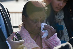 © Licensed to London News Pictures. 04/01/2012. London, UK.  YOGINI BIDVE, mother of murdered indian student ANUJ BIDVE wipes a tear from her eye during a press conference outside the Houses of Parliament London on January 4th, 2012 after arriving in the UK from Mumbai. The Family of 20 year-old ANUJ BIDVE, are expected to travel to Manchester to visit the scene where ANUJ was shot dead.  Photo credit: Ben Cawthra/LNP
