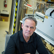 """Tim Lyons, Professor of Geology, in his office and a lab in the Geology building at the University of California, Riverside where """"cluster hiring"""" has been instituted."""