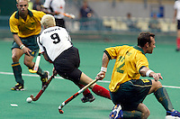 10th Men's World Cup Fieldhockey. South Africa vs Germany (0-3). German Oliver Domke (9) is too fast for Southafrican Justin King (r).
