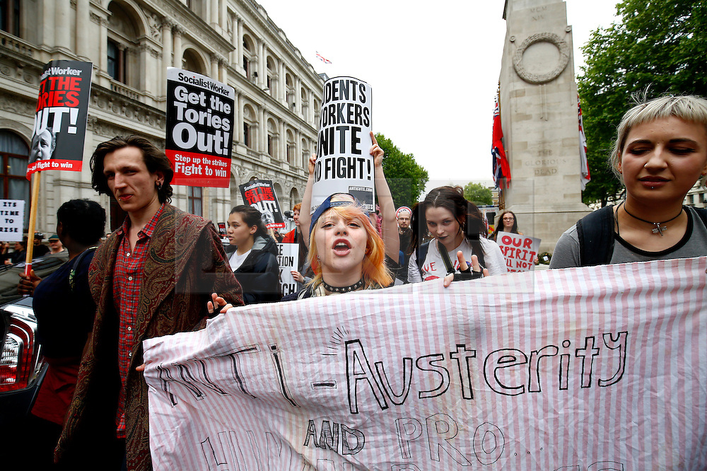 © Licensed to London News Pictures. 27/05/2015. Westminster, UK. Demonstrators take part in an End Austerity Now protest, which starts outside Downing Street in London.  Activists are demonstrating against the current conservative government and planned spending cuts. At a previous demonstration by the same group  a war memorial on Whitehall was defaced. Photo credit: Tolga Akmen/LNP