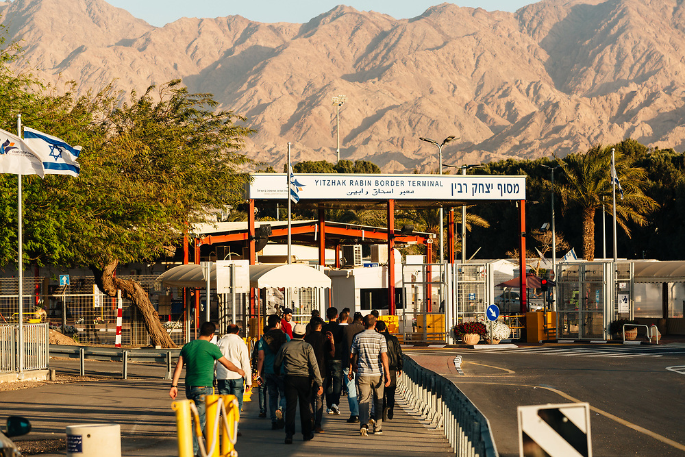 Jordanian workers make their way into the Yitzhak Rabin Border Terminal in Eilat, southern Israel, on March 14, 2018,  before crossing the border from Israel into Jordan, at the conclusion of their workday in various hotels in Eilat.