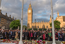 © Licensed to London News Pictures. 17/06/2016. London, UK. Wellwishers, mourners and members of the public attend an evening vigil in Parliament Square for Jo Cox, Labour MP for Batley and Spen, who was murdered the previous day whilst en route to her constituency surgery. Photo credit : Stephen Chung/LNP