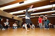 Glenn Wong, Senior Civil Engineering, breakdances at the Human Rights Lecture in the Barrett Ballroom at the Student Union, San Jose State University, San Jose, Calif., on March 21, 2012.  Photo by Stan Olszewski