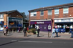 Social distancing queue outside Nat West bank during Coronavirus pandemic, Tilehurst, Reading, UK March 2020