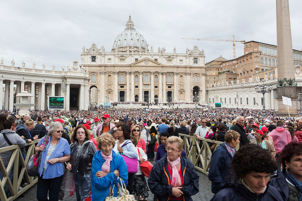 VATICAN - 24 SEPTEMBER 2014: Faithfuls walk away from St-Peter's Square after attending the Wednesday udienza by Pope Francis at the Vatican, on September 24th 2014.<br /> <br /> The Vatican has announced that souvenir shops in Rome will no longer be allowed to sell plaques and parchments with papal blessings. Bishop Konrad Krajewski, the papal almoner, informed the shopkeepers in April that beginning on January 1, 2015, the papal blessings will only be available through at the Office of Papal Charities. All profits from the sale of these documents will go to the papal charities.
