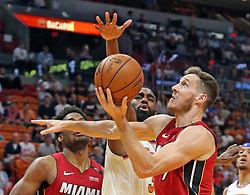 March 21, 2018 - Miami, FL, USA - The Miami Heat's Goran Dragic looks to shoot under pressure from the New York Knicks' Tim Hardaway Jr. in the first quarter at the AmericanAirlines Arena in Miami on Wednesday, March 21, 2018. (Credit Image: © Charles Trainor Jr/TNS via ZUMA Wire)