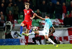 Eric Dier of England beats Rok Kronaveter of Slovenia to the ball - Mandatory by-line: Robbie Stephenson/JMP - 11/10/2016 - FOOTBALL - RSC Stozice - Ljubljana, England - Slovenia v England - World Cup European Qualifier