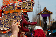 A shinto priest wearing a demon mask during the Kanamara matsuri or festival of the Steel phallus Kawasaki Daishi, Kawasaki, Kanagawa, Japan. Sunday, April 2nd 2017. The Kanamara Penis festival takes place on the first Sunday of April and celebrates the local legend of a penis eating demon who was defeated after being tricked into biting a steel phallus. The festival is popular with Japan's gay community and now uses its notoriety to raise money for HIV and AIDS charities. It is also wildly popular with foreign and Japanese.tourists.