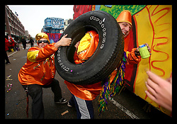 18th Feb, 2006. New Orleans, Louisiana. The first parades of Mardi Gras 2006. Krewes from Pegasus and Sparta dismount their floats on Tchoupitoulas Street in the Central Business district where they laugh and joke and dispense the last of their beads and floats to the waiting crowds celebrating the return of Mardi Gras to New Orleans.