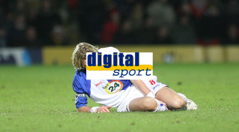 Photo: Marc Atkins.<br /> Watford v Blackburn Rovers. The Barclays Premiership. 23/01/2007. Robbie Savage lays on the floor after sustaining a leg injury in a challenge with Al Bangura of Watford.