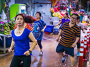 11 AUGUST 2016 - BANGKOK, THAILAND:   An aerobics class in Pak Khlong Talat, better known as the Bangkok Flower Market. Public exercise classes are common throughout Thailand. Most of the participants in the exercise class in the Bangkok flower market are older adults, although the class is open to everyone.        PHOTO BY JACK KURTZ