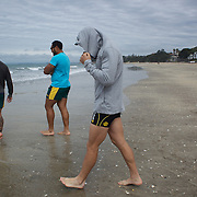 A hooded Quade Cooper heads for the water during the Australian teams recovery session at  Takapuna Beach at the IRB Rugby World Cup tournament, Auckland, New Zealand, 17th October 2011. Photo Tim Clayton...