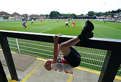 A young child watches the action between the Head for Change and the Solan Connor Fawcett Trust charity match at Spennymoor Town FC, County Durham. Picture date: Sunday September 26, 2021.