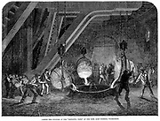 Casting the cylinders for the hydraulic press (lift) used to raise the prefabricated sections of the Britannia Tubular Bridge across the Menai Straits, Wales. Nasmyth safety ladles (1838) being used  Wood engraving, 1851