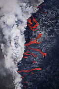 Kilauea's east rift zone: Dozens of rivulets of lava enter the sea at Kapoho, creating the newest real estate on the planet.