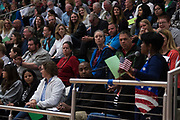 Citizens look on while a question is being asked towards U.S. Rep. Michael C. Burgess during a town hall meeting within his district at Flower Mound Marcus High School in Flower Mound, Texas on March 4, 2017.  (Cooper Neill for The Texas Tribune)