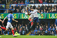 Portsmouth Forward, Brett Pitman (8) and Wycombe Wanderers Defender, Sido Jombati (2) challenge for the ball during the EFL Sky Bet League 1 match between Portsmouth and Wycombe Wanderers at Fratton Park, Portsmouth, England on 22 September 2018.
