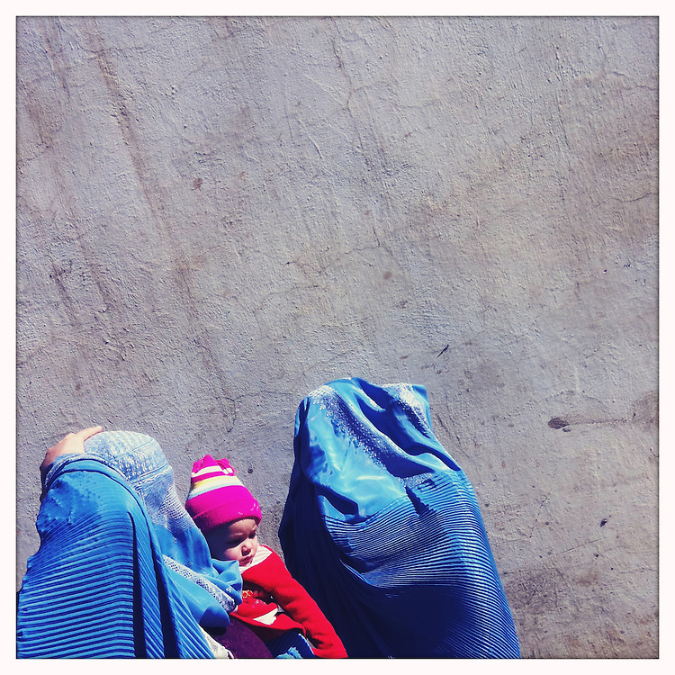 Women walk with a baby.
