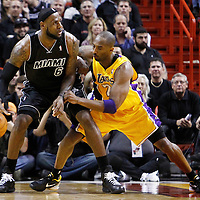 19 January 2012: Los Angeles Lakers shooting guard Kobe Bryant (24) defends on Miami Heat small forward LeBron James (6) during the first all of NBA game Los Angeles Lakers at Miami Heat, at the AmericanAirlines Arena, Miami, Florida, USA.