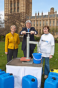 Andrew Mitchell  MP, Barbara Frost and a WaterAid campaigner pumping for water. Marking World Water Day, over 40 MP's walked for water at Westminster, London at an event organised by WaterAid and Tearfund. Globally hundreds of thousands of people took part in the campaign to raise awareness of the world water crisis.