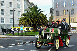 © Licensed to London News Pictures. 03/11/2019. LONDON, UK.  Participants drive through the capital en route to the coast in the 123rd Bonhams London to Brighton Veteran Car Run.  The 60 mile journey is undertaken by over 600 pre-1905 manufactured vehicles, some of which suffer frequent breakdowns.  The Run commemorates the Emancipation Run of 14 November 1896, which celebrated the Locomotives on the Highway Act, when the speed limit for 'light locomotives' was raised from 4 mph to 14 mph, abolishing the need for vehicles to be preceded by a man on foot.  Photo credit: Stephen Chung/LNP