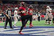 Daryel Lozoya #17 of the Iraan High School football team scores a touchdown during the state championship game at AT&T Stadium in Arlington, Texas on December 15, 2016. (Cooper Neill for The New York Times)