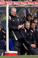 Photo: Glyn Thomas.<br />Birmingham City v Sunderland. The Barclays Premiership. 25/02/2006.<br />Sunderland's manager Mick McCarthy writes himself some notes.