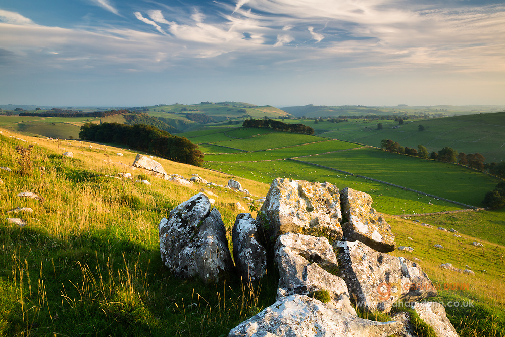 Warm evening light on Wolfscote Hill, a limestone boulder strewn peak which stands between Wolfscote Dale & Biggin Dale. Looking south towards Dove Dale. Derbyshire, Peak District National Park, England, UK. Autumn.
