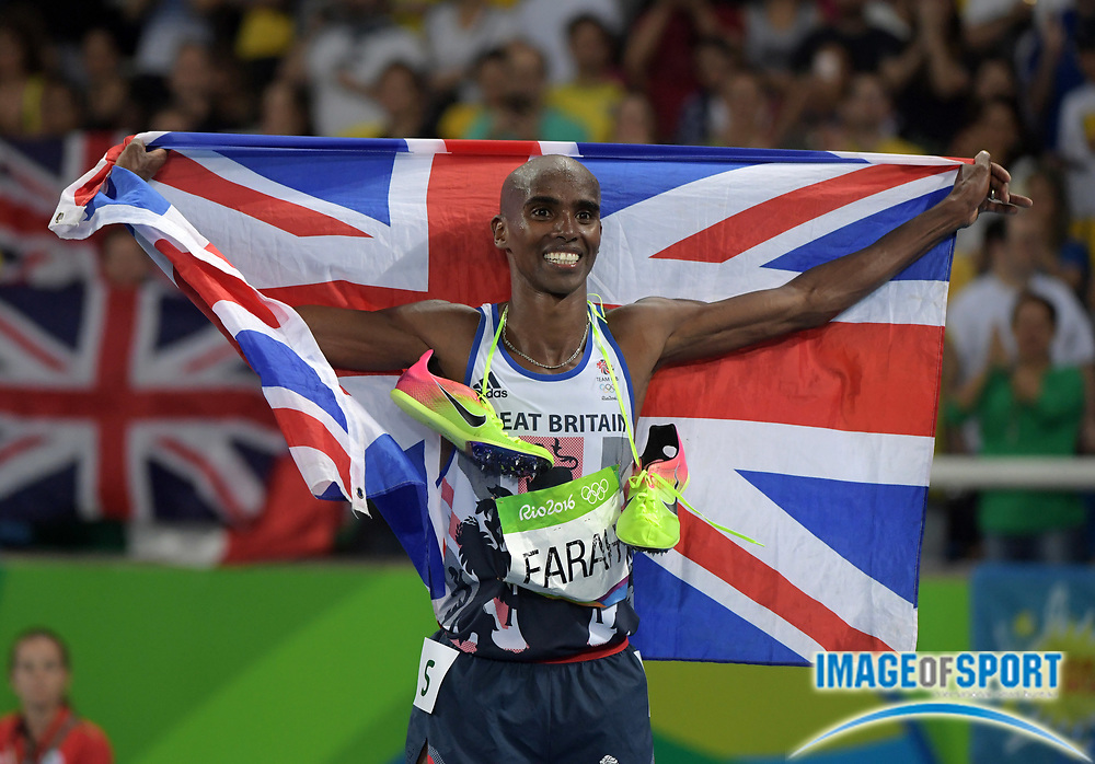 Aug 18, 2016; Rio de Janeiro, Brazil; Mo Farah aka Mohamed Farah (GBR) poses with British flag after winning the 5,000m in 13:03.30 during the 2016 Rio Olympics at Estadio Olimpico Joao Havelange. <br /> <br /> *