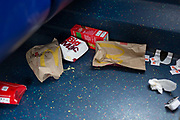 Dropped McDonalds packaging and food remains on the floor of a London bus, on 3rd October 2019, in south London, England.