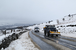 © Licensed to London News Pictures.04/03/16. Ilkley, UK.  A land rover fitted with a snow plough makes it's way up to the snow covered hills in Ilkley after heavy snowfall over night in Yorkshire caused chaos on many roads. Forecasters are predicting more cold weather this week as Storm Jake takes hold. Photo credit : Ian Hinchliffe/LNP