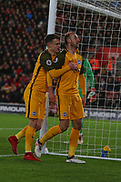 Football - 2017 / 2018 Premier League - Southampton vs. Brighton and Hove Albion<br /> <br /> Glenn Murray of Brighton gets congratulated by teammate Solly March of Brighton won won the penalty that Murray converted at St Mary's Stadium Southampton<br /> <br /> COLORSPORT/SHAUN BOGGUST