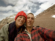 Mareile and Matthieu Paley on Irshad Uween Pass. Going over the 4925m Irshad Uween pass, the border between Afghanistan and Pakistan, in our last days trek..<br /> <br /> Adventure through the Afghan Pamir mountains, among the Afghan Kyrgyz and into Pakistan's Karakoram mountains. July/August 2005. Afghanistan / Pakistan.