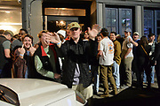 """3/4/21 Oxford, Mississippi Students of The University of Mississippi, aka, Ole Miss, party and enjoy a night out on the second night after Governor Tate Reeves lifted the state wide mask mandate. Pictured is a group of students waiting to get into a bar called Rafters in downtown Oxford.The Library bar and Rafters in downtown Oxford were packed with students shoulder to shoulder drinking and partying. Dr Fauci has stated that Mississippi and Texas residents should continue to abide by public health measures, including wearing masks and social distancing, even as Republican Governors have lifted all Covid-19 restrictions in Texas and Mississippi. In a move President Biden has called """"Neanderthal thinking"""" , which Governor Tate Reeves of Mississippi took offense too. Governor Tate Reeves dropped the mask mandate March 3rd, 2021. Mississippians had mixed feelings regarding the mask mandate to begin with and the Governors  lack of leadership regarding Covid-19 and the pandemic. Photo© Suzi Altman"""
