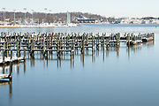 Empty piers on icy river