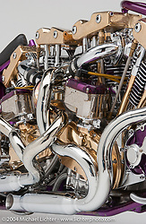 """""""Two Bad,"""" built by Arlen Ness. This bike is a 2,000-cc twin-engined Sportster built in 1987 with torsion bar suspension, center hub steering, a Magnuson supercharger, two Weber carburetors, two batteries, four gas tanks, gold leaf paint, and twisted exhaust pipes. This took first place in the Harley-Davidson ride-in show in Daytona and first debuted at the Oakland Roadster Show. <br /> <br /> Appears in the Arlen Ness book """"The King of Choppers,"""" by Michael Lichter and Arlen Ness."""