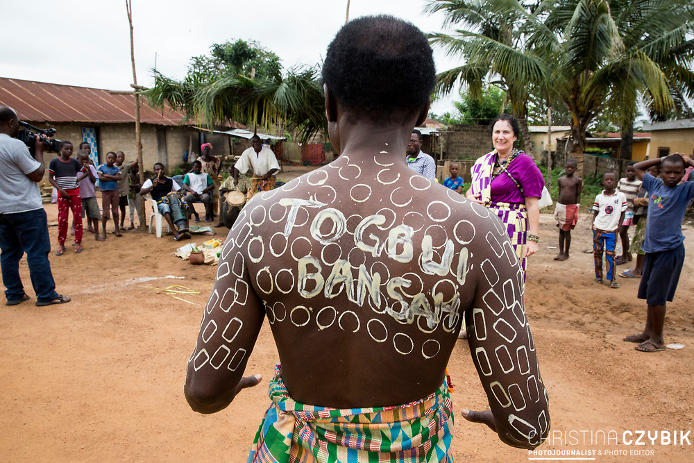 King Cephas Bansah with a traditional body painting that symbolizes strength and cautiousness in front of the home of Ewefiaga Togbui Agboli K.F.Agokoli IV (King of the Ewe) in Notse<br /> <br /> Day 1 of the Agbogboza Festival in Notse, Togo on September 1st, 2016<br /> <br /> ***Togbe Ngoryifia Cephas Kosi Bansah of Gbi Traditional Area Hohoe Ghana and Traditional, Spiritual and Honorable King of the Ewes and his wife, Queen Mother Gabriele Akosua Bansah Ahado Hohoe Ghana***
