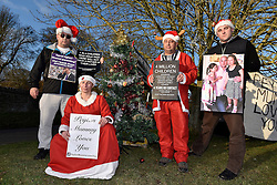 © Licensed to London News Pictures. 24/12/2014. Dean, Oxfordshire UK. (L-R) Terry Vooght, Carol Wheeler,, James Dennis, Bobby Smith. Fathers for Justice protestors plan to spend Christmas protesting in the village of Dean where the Prime Minister David Cameron lives. The protestors are led by Bobby Smith, long time protestor who protested to David Cameron during his surf holiday at Polzeath in August 2014. Photo credit : MARK HEMSWORTH/LNP