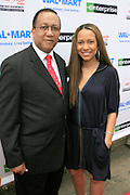 """Dr. Ben Chavis Muhummad and Valiesha Butterfield at the Hip-Hop Summit's """"Get Your Money Right"""" Financial Empowerment International Tour draws hip-hop stars and financial experts to teach young people about financial literacy held at The Johnson C. Smith University's Brayboy Gymnasium on April 26, 2008..For the past three years, hip-hop stars have come out around the country to give back to their communities. Sharing personal stories about the mistakes they've made with their own finances along the way, and emphasizing the difference between the bling fantasy of videos and the realities of life, has helped young people learn the importance of financial responsibility while they're still young. With the recent housing market crash in the United States affecting the economy, jobs, student loans and consumer confidence, young people are eager to receive sound financial advice on how to best manage their money and navigate through this volatile economic environment.."""