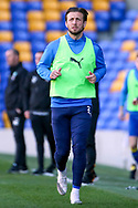 AFC Wimbledon defender Luke O'Neill (2) warming up as sub during the EFL Sky Bet League 1 match between AFC Wimbledon and Hull City at Plough Lane, London, United Kingdom on 27 February 2021.