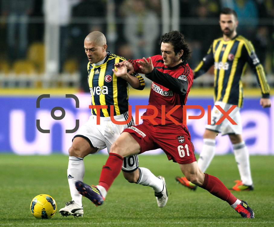 Fenerbahce's Alexsandro de Souza (L) and Gaziantepspor's Orhan Gulle (R) during their Turkish superleague soccer match Fenerbahce between Gaziantepspor at the Sukru Saracaoglu stadium in Istanbul Turkey on Monday09 January 2011. Photo by TURKPIX
