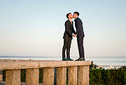 Nate and Dave share a wedding day kiss standing on the granite wall of the Pilgrim Momument in Provincetown on Saturday, September 7, 2019.