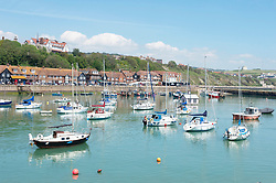 © Licensed to London News Pictures 14/06/2021. Folkestone, UK. The Harbour. The hot heatwave weather continues today in Kent as people enjoy the sun in Folkestone Harbour. Photo credit:Grant Falvey/LNP