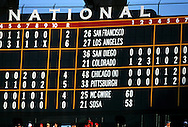 "ST. LOUIS, MO-SEPTEMBER 1998:   The scoreboard in St. Louis keeps track of the ""Great Home Run Race"" between Mark McGwire #25 of the St. Louis Cardinals and Sammy Sosa of the Chicago Cubs as they both attempted to break the single season home run record held by Roger Maris in 1961.  (Photo by Ron Vesely)"