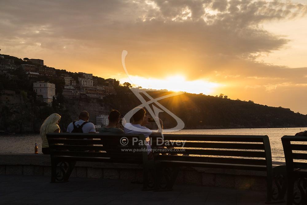 Sorrento, Italy, September 16 2017. People watch the sun set from Marina Piccola in Sorrento, Italy. © Paul Davey