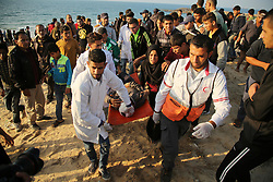 November 19, 2018 - Beit Lahia, Gaza Strip, Palestinian Territory - A wounded Palestinian protester is evacuated during clashes with Israeli forces in a demonstration against the Israeli blockade on Gaza Strip, along the Gaza sea barrier on the maritime border with Israel near Kibbutz Zikim, north of Beit Lahia in the northern Gaza Strip.  (Credit Image: © Dawoud Abo Alkas/APA Images via ZUMA Wire)
